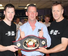ProKick fighter, Johnny 'Swift' Smith (left) receives backing for world Glory. PPLK have backed Prokick events in the past and Billy Murray (right) is delighted that Mr Fyfe (center) & Co are helping again.