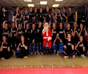 Kris Kringle known as Father Christmas was at the ProKick Gym in Belfast - first-up he visited the kicking mad Kids and stayed on to watch the adult competition .