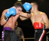 Karl McBlain takes a solid shot from Swiss fighter Omar Touiki