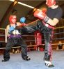ProKick fighter Stefanie McMullen slips a hard side kick from Laeticia Mauerhofer