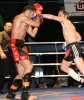 Ian Young lands a hard punch to France' Jamal Wahib in their international bout in Switzerland