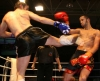 Ian Young was kick high in Kickboxing action in Switzerland against Jamal Wahib of France