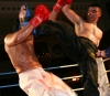 Poland's Borowiew drops a kick on Riyadh Al Azzawi in their WKN world title match