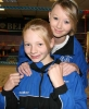 A young Prokick kickboxer, Alex Catherwood with her sister Alana at the ProKick gym