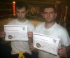 Two new Orange belters Mark And Adrian - A grading is when Kickboxing students, non-contact and contact, are assessed through a series of levels / grades, with the base level being White Belt