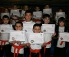 kickboxing kids go for green, young members (pictured) all took a test to grade for Green belt.