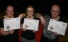 kickboxing Christie family - mum, dad and daughter advance from beginners to the yellow belt class.