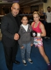 ProKick fighter Ursula Agnew's opponent Maria Pantazi with WKN Official and young fan after the event in Nicosia, Cyprus on 9th March 2012.