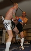 ProKick fighter Darren McMullan takes a hard roundhouse kick from opponent Barry Haberland from Holland.