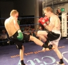 Bo Desselbrine (Holland) fires a Low-Kick to Gary Fullerton at Thai-Tanic event but it is well blocked