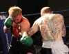 Action from Thai-Tanic Gary Fullerton lands hard strikes to Dutch fighter Bo Desselbrine