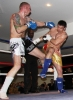 ProKick's Darren McMullan lands a low kick on opponent Chris Lovell during their K1 style match on 25th February 2012 in Staines, Essex.