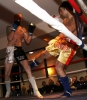 ProKick's Darren McMullan absorbs a low kick from opponent Chris Lovell during their K1 style match on 25th February 2012 in Staines, Essex.