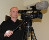 Injured ProKick fighter Darren McMullan working the video camera at the event in Nicosia, Cyprus on 9th March 2012.