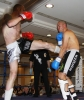 ProKick fighter Darren McMullan lands a hard front kick on opponent Barry Haberland from Holland.