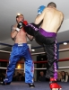 ProKick's Davy Foster lands a hard front kick on opponent Scott Bryant on 25th February 2012 in Staines, Essex.