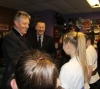 The new ProKick junior Black Belts and their parents greeting the First Minister on his visit to ProKick HQ