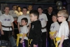 ProKick junior members watch on as Northern Ireland First Minister Peter Robinson presents 4 team mates their Black Belts