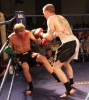Action from Thai-Tanic Gary Fullerton lands hard knees to Dutch fighter Bo Desselbrine