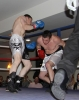 ProKick's Johnny Smith lands another body shot during his first competitive boxing match on 25th February 2012 in Staines, Essex.