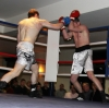 ProKick's Johnny Smith lands a hard right hand to opponent Steve Wilkinson during his first competitive boxing match on 25th February 2012 in Staines, Essex.