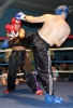 ProKick's Karl McBlain blocking a hard roundhouse kick from England's Dean Petty