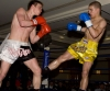 Mark Bird takes a low kick in an Oriental rules K1 Style 4x2 match with Kevin Eiberg (Germany)