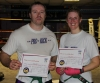New ProKick Blue Belts Arran Young and Christine Honnor posing happily after a hard grading day at ProKick HQ