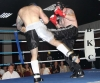 Paul Best lands a thindering low kick to the thigh of John Mullally
