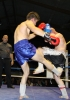 ProKick battler Stuart Jess covers up against some hard shots from opponent Loic Jeannin