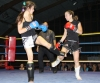 ProKick's Ursula Agnew throws a hard low kick to Swiss opponent Marie-Pierre Limeanstett
