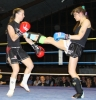 ProKick fighter Ursula Agnew lands a hard front kick on Marie-Pierre Limeanstett