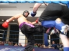 Gary Jess lands a hard low kick against opponent Barry Walker