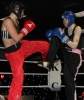 ProKick's Ursula Agnew blocks a hard roundhouse kick from Lindsey Doyle