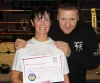 New ProKick Brown Belt Pauline Goody smiles with pride with ProKick Head Coach Billy Murray after a hard grading