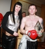 ProKick fighter Johnny Smith being presented the Award for Fighter Of The Year 2010/11 by Adele Robinson.
