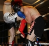 ProKick fighter Johnny Smith lands a pin-point knee strike on Joe Harte from Waterford