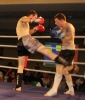 ProKick fighter Johnny Smith takes a hard low kick from Daryl Orr