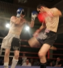 ProKick fighter Johnny Smith slipping a hard low kick from Daryl Orr