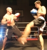 Peter Rusk taking the fight forward with a strong low kick