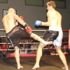 ProKick's Peter Rusk taking a hard low kick from Aidan Brooks