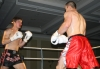 Peter Rusk takes the fight to opponent Rustam Guseinov