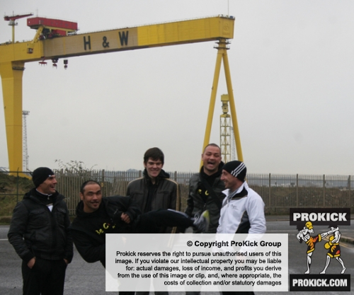Kickboxing coaches Toni Haberland and Noel Merceica meet 'Goliath' the crane during their tour of the City of Belfast.
