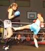 Ursula Agnew slips a hard low kick from Donna Larkin