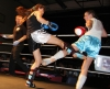 ProKick's Ursula Agnew takes a hard low kick from Donna Larkin