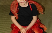 The little lady bird sitting peacefully at the fancy dress night.124