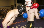 Pope and Cox in kickboxing action