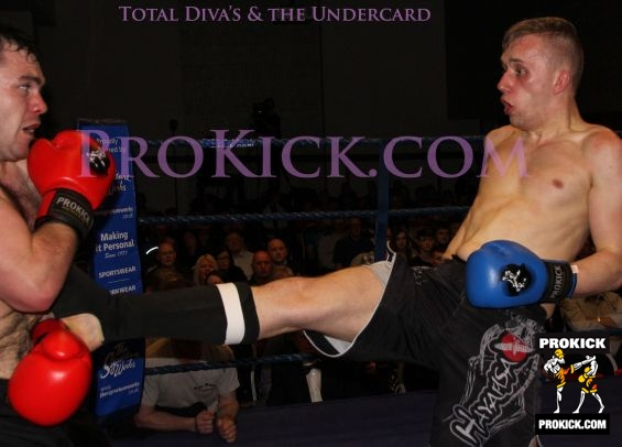 David gets knocked back from front kick
