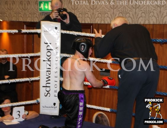 Tim takes a count from referee Bob Hunter